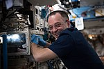 ISS-55 Ricky Arnold performs maintenance inside the Destiny lab.jpg