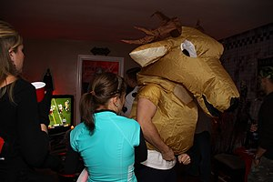 Inflatable costume - A man wearing an inflatable deer costume