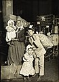 Italian family in the baggage room, Ellis Island, 1905.jpg