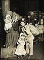 Italian family in the baggage room, Ellis Island, 1905.jpg