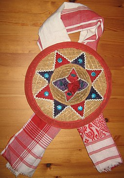 A decorative Assamese Jaapi laid over a Gamosa Jaapi with Gamosa.jpg