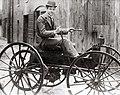 John D. Perry Lewis and his battery powered horseless vehicle, the first in St. Louis.jpg
