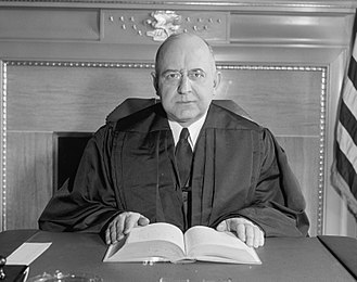 Stanley Forman Reed - Image: Justice Stanley Reed at desk (cropped)
