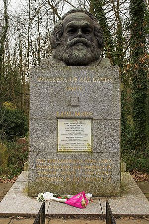 "Workers of the world, unite! - Marx's grave at Highgate Cemetery, bearing the slogan ""Workers of All Lands Unite""."