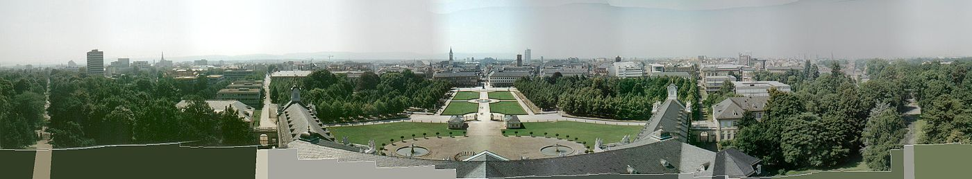Panorama of Karlsruhe, looking south from the palace tower. The Institute of Technology is on the left, the Market square in the centre, the Federal Constitutional Court on the right. Note wings of the palace aligning with streets, all radiating out from the centre of town (i.e., the palace tower). - Karlsruhe