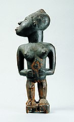 Power statue of a standing woman (nkisi) of the Kongo people