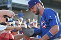 Kris Bryant signing autographs during his rehab assignment against Omaha (30447680078).jpg