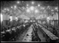 Large group of apprentices seated for their first exam at the Hutt Railway Workshops in 1930, situated in the staff social hall at the workshops ATLIB 311637.png