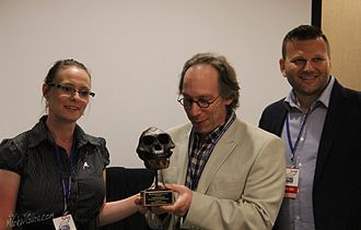 Lawrence M. Krauss - Krauss is given the Richard Dawkins Award by Mark W. Gura and Melissa Pugh of Atheist Alliance of America at the Reason Rally 2016