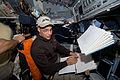 Lee Archambault going over a check list on the shuttle flight deck.jpg
