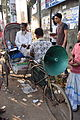 Local medicine seller at GEC circle on a rickshaw in Chittagong.JPG