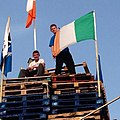 Loyalist Youths prepare to burn an Irish flag on a 12th of July bonfire.JPG