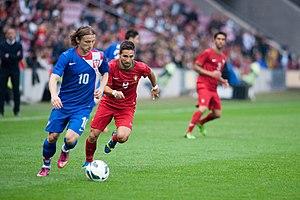João Moutinho - Croatia's Luka Modrić (front) battles Moutinho for the ball in a friendly match in June 2013