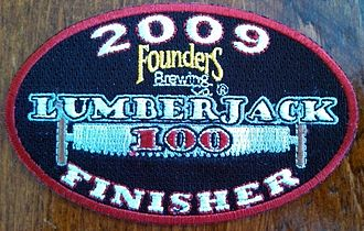 Lumberjack 100 - This image is a photograph of the patch (badge) awarded to all finishers of the 2009 Founder's Brewing Company Lumberjack 100 mountain bike (bicycle) race (Michigan, USA).