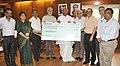 Mallikarjun Kharge receiving a cheque of Rs. 50 lakh from the Managing Director, Indian Railway Finance Corporation Ltd. (IRFC), Shri Rajiv Datt.jpg