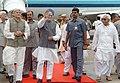 Manmohan Singh with the Governor of West Bengal, Shri Gopalkrishna Gandhi and the Chief Minister of West Bengal, Shri Buddhadev Bhattacharya at Netaji Subhash Chandra Bose International Airport, Kolkata on July 11, 2006.jpg