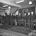 Mannen in jacquets op podium, 4e en 5e van links respectievelijk Jan en Albert v, Bestanddeelnr 255-8443.jpg