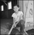 Manzanar Relocation Center, Manzanar, California. Evacuee boy waiting at the entrance of the Recrea . . . - NARA - 538074.tif