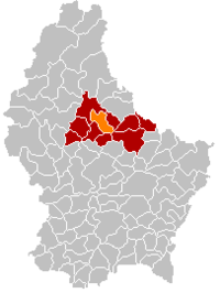 Map of Luxembourg with Erpeldange highlighted in orange, the district in dark grey, and the canton in dark red