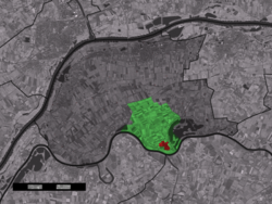 The town centre (red) and the statistical district (light green) of Maasbommel in the municipality of West Maas en Waal.