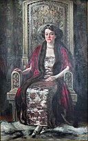 Maryhill Museum - Richard Hall - Alma de Bretteville Spreckels in Queen Marie of Roumania's audience chair (1924) 01.jpg