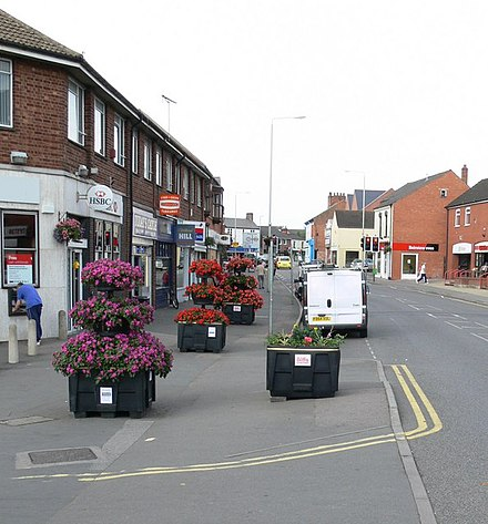 Melton Road from the Brook Bridge. Melton Road, Syston - geograph.org.uk - 497773.jpg