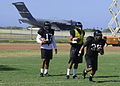 Members of the University Of Hawaii Rainbow Warrior football team practice at Earhart Field on Joint Base Pearl Harbor-Hickam Aug. 15, 2013, in Hawaii 130815-N-DT805-004.jpg