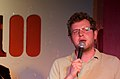 Miles Jupp with a microphone in 2009.jpg