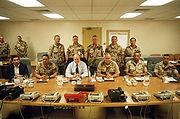 Senior United States military officials preparing to discuss the possibility of invasion, including Undersecretary of Defense Paul Wolfowitz, Gen. Colin Powell, Secretary of Defense Dick Cheney, and Gen. Norman Schwarzkopf.