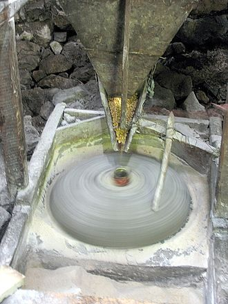 Millstone - Grinding maize in a watermill, Thethi, northern Albania