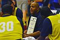 Mo Philips, center, the coach of the Navy-Coast Guard Hawaii wheelchair basketball team, discusses strategy during a timeout in a game against the Air Force team during the Wounded Warrior Pacific Invitational 140109-N-HA927-008.jpg