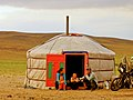 Mongolian family in front of her ger.jpg