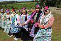 Mujeres mapuches en la entrega terreno a Comunidad Mapuche Lorenzo Quintrileo de Tirúa.jpg