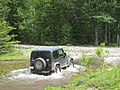 My friend's Jeep goes through one of the uncountable number of streams. - Flickr - dave 7.jpg