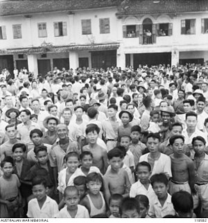 Sarawak - Large crowd of Sarawak native population throngs the street of Kuching to witness the arrival of Australian Imperial Force (AIF) on 12 September 1945.