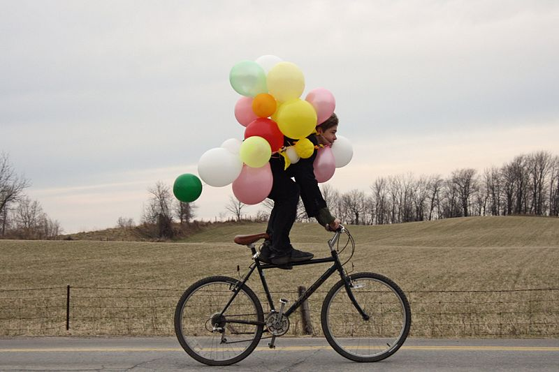 File:Nicki Varkevisser - Man on bicycle with balloons.jpg
