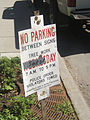 No Parking Sign with Duct Tape (2185129428).jpg
