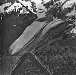 Northeastern Glacier, terminus of valley glacier, rockslide covering part of the glacier, firn line in the background, and (GLACIERS 6680).jpg