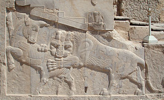 Relief - Persian low or bas-relief in Persepolis – a symbol of Zoroastrian Nowruz – at the spring equinox the power of  the bull (personifying Earth) and lion (personifying the Sun) are equal.