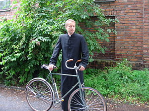 Ojciec Mateusz - Father Mateusz with his familiar bike
