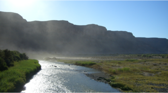 Vioolsdrif - The Orange River from the border bridge between Noordoewer and Vioolsdrif. Extreme heat and sunlight cause visible evaporation.