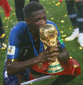 The current trophy (held by France forward Ousmane Dembele in 2018) has been presented since 1974 Ousmane Dembele World Cup Trophy.jpg