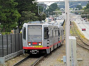Outbound M Ocean View train arriving at SFSU, July 2017.JPG