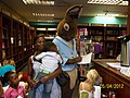Owen's Wife & family visiting from Zimbabwe introduced to a bookshop & meeting Peter rabbit 05042012.jpg