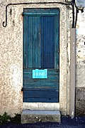 Painted door with a home sign on it.jpg