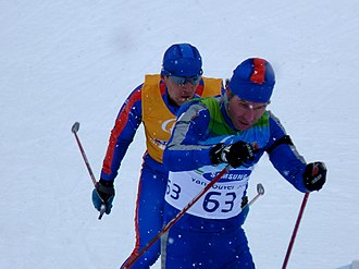 Russia at the 2010 Winter Paralympics - Irek Mannanov in qualification for the Biathlon Men's 3 km Pursuit (Visually Impaired) guided by Salavat Gumerov (in the yellow shirt).
