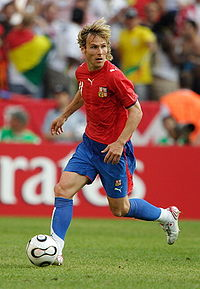 Nedvěd wearing the red shirt, blue shorts and blue socks of the Czech Republic