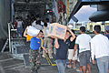 Philippine service members and residents unload relief supplies from a Philippine Air Force C-130 Hercules aircraft during Operation Damayan in Ormoc, Philippines, Nov. 16, 2013 131116-F-ZZ999-009.jpg