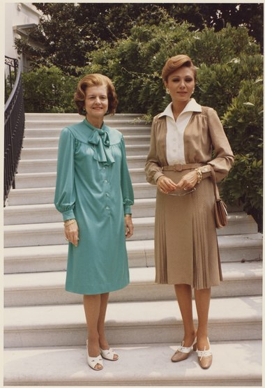 U.S. First Lady Betty Ford (left) with Farah Pahlavi, 1975 Photograph of First Lady Betty Ford with the Shahbanou (Empress) of Iran on the Steps Leading to the Truman Balcony... - NARA - 186813.tif