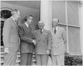 Photograph of President Truman in the White House Rose Garden shaking hands with W. Averell Harriman, Special... - NARA - 200334.tif